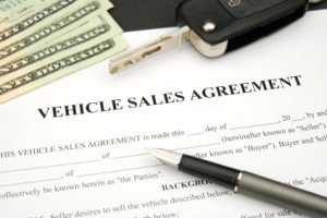Vehicle Sales Agreement with car key and money and document