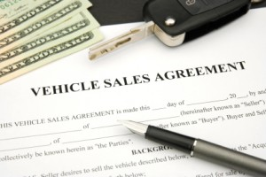Vehicle Sales Agreement with car key and money